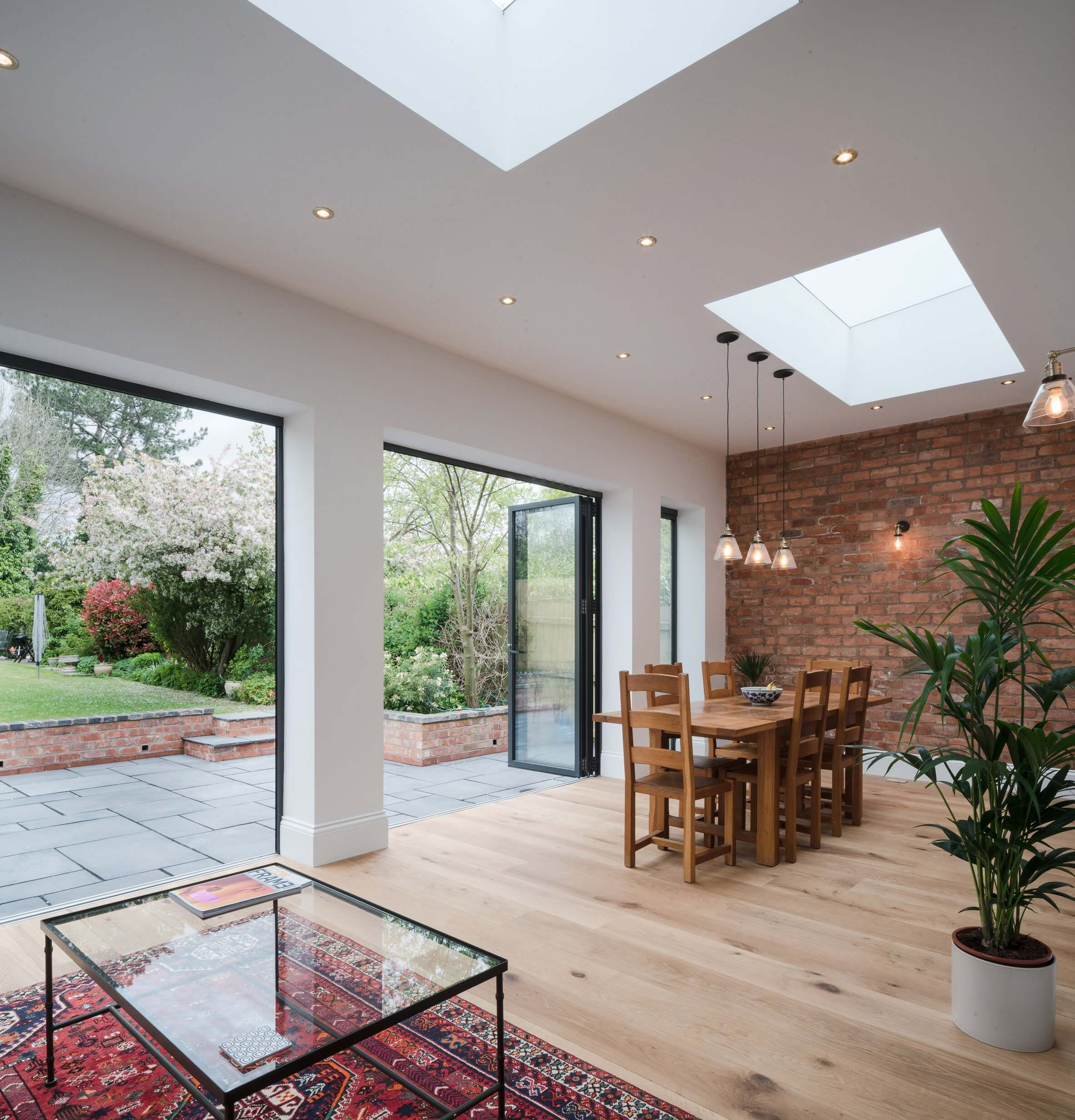 Rear modern home extension open plan living dining room milestone loft conversion specialists for Modern open plan house designs ireland